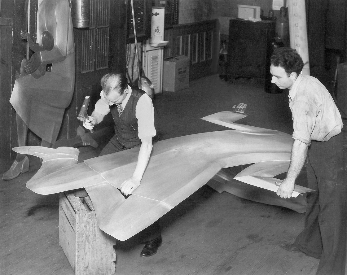 Craftsmen at the Rambusch Studio fabricating a metal figure for Hippocrates, the Father of Medicine and the Dragon of Ignorance by Hildreth Meière for the 1939 New York World