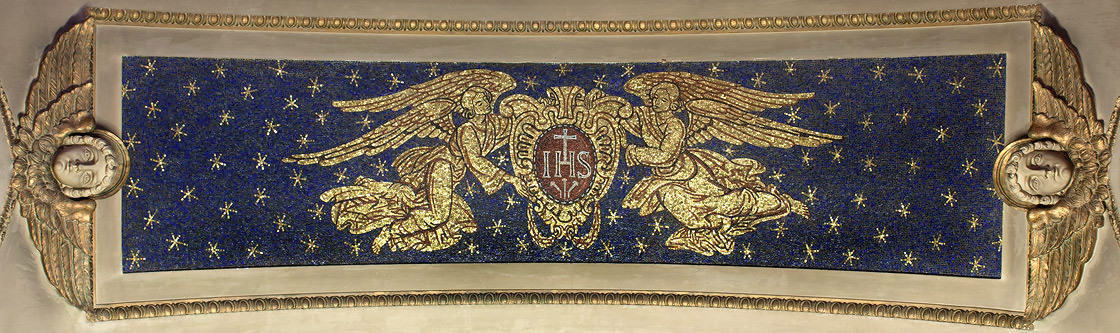 Angels with the Seal of the Society of Jesus on barrel-vaulted ceiling
