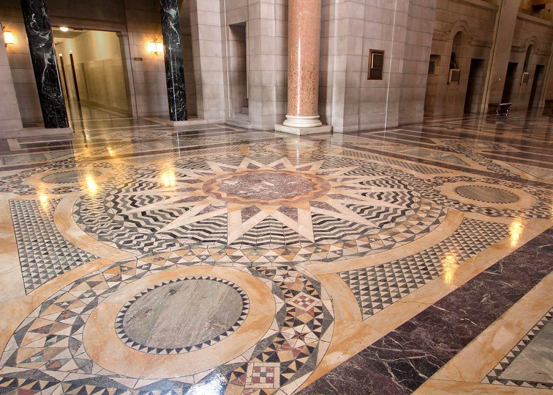 Cosmic Sun symbolizing Creation on vestibule floor