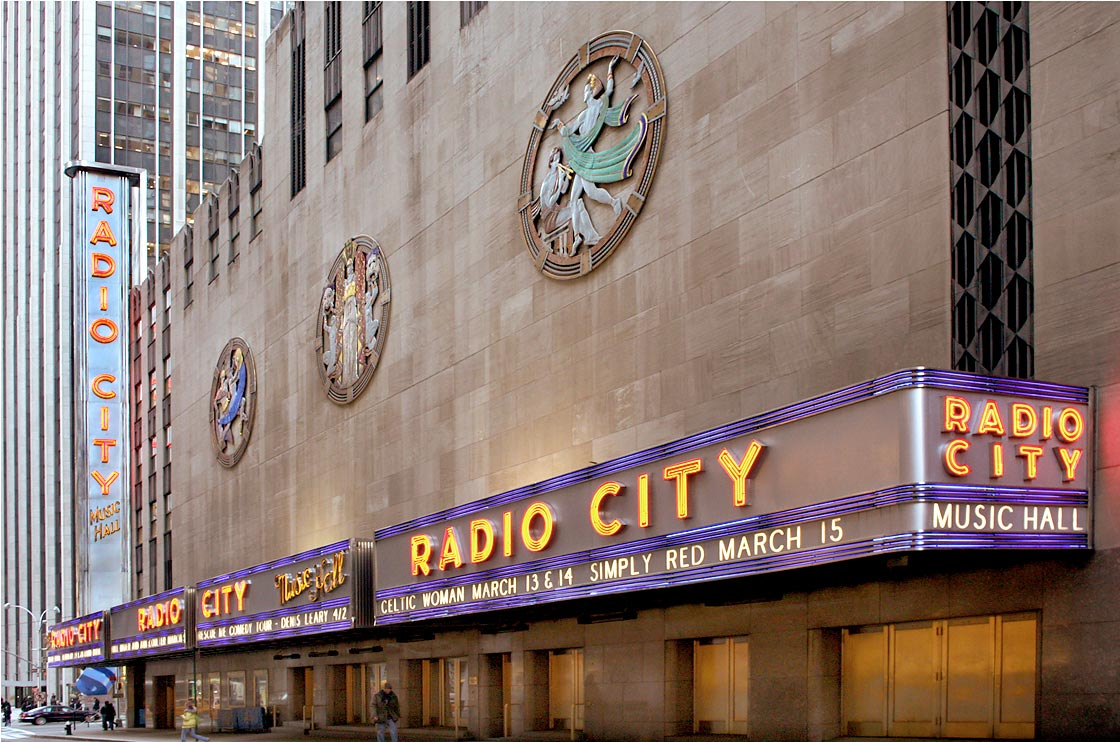 50th street facade of Radio City Music Hall with iconic Dance, Drama and Song in mixed metal and enamel