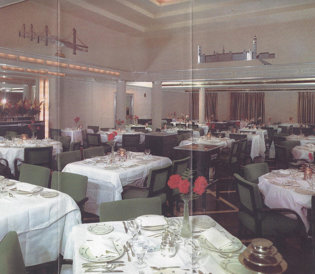 Cabin class dining room with wall sculptures representing San Francisco on left and London on right