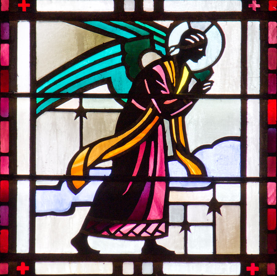 Detail of angel from Gloria in Excelsis Deo showing use of lead cames to create design