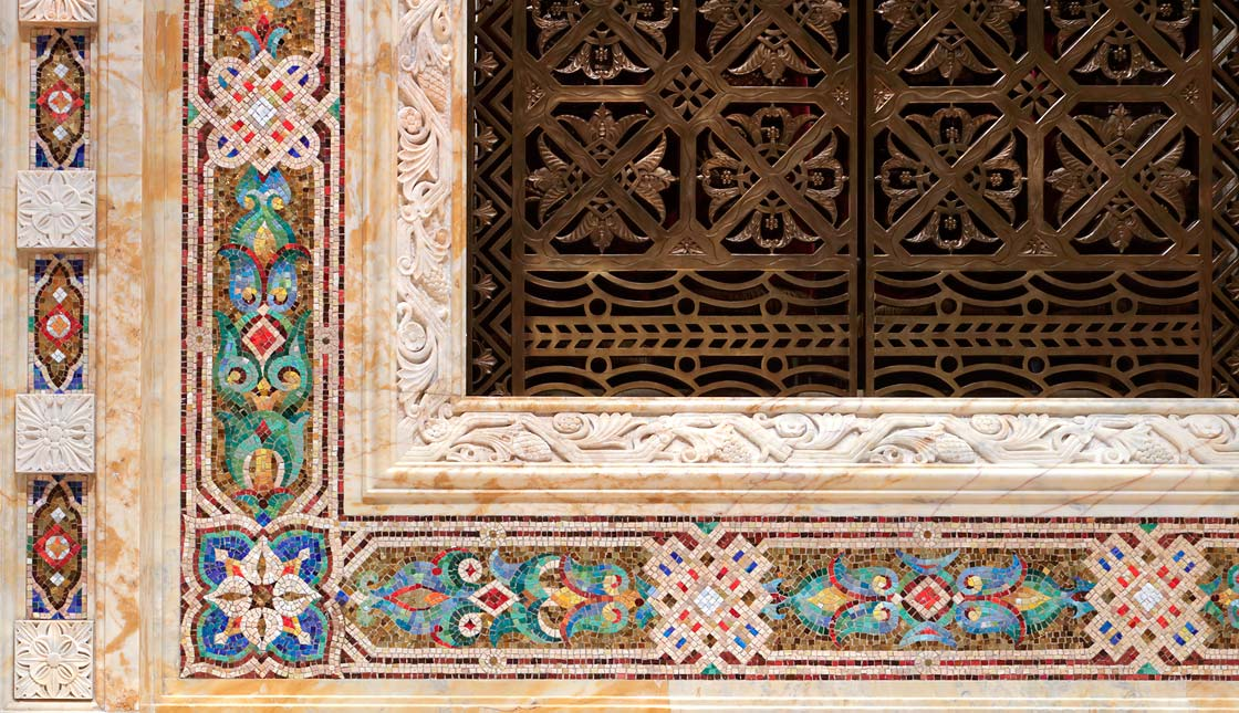 Details of floral design punctuated by quatrefoil shapes