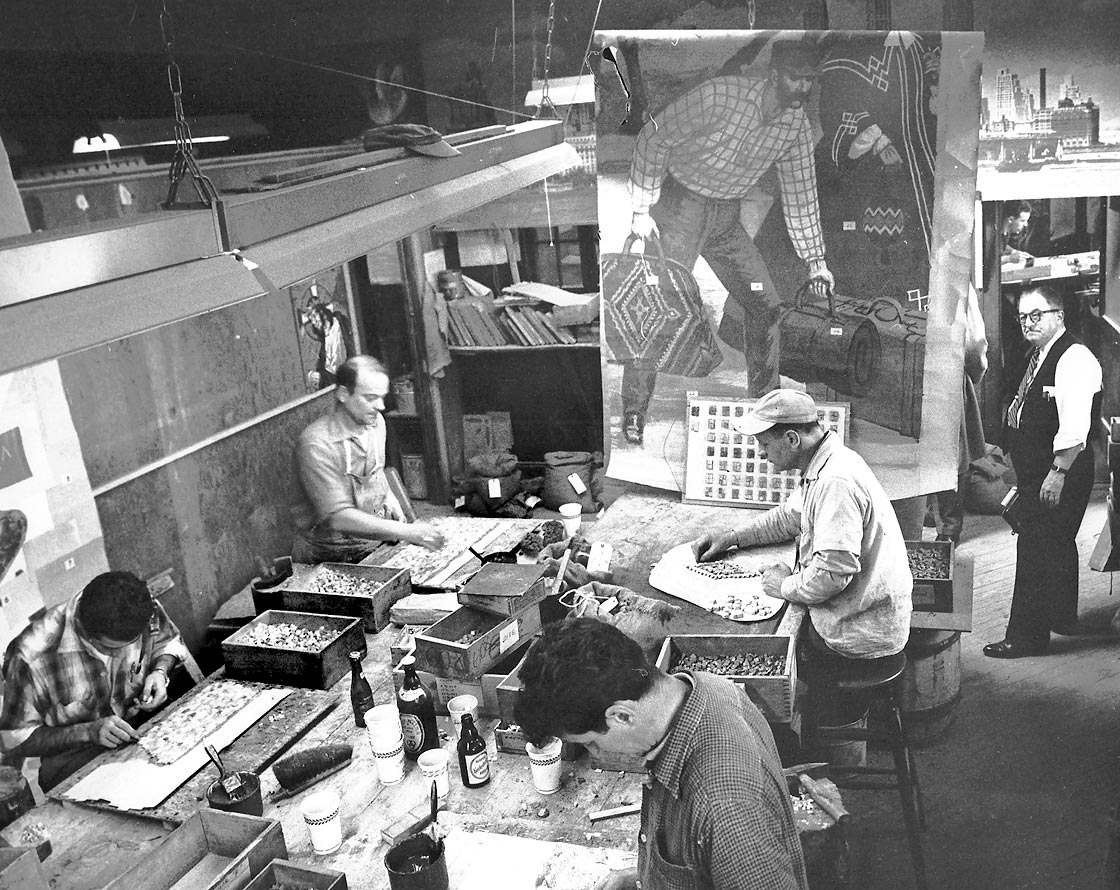 Mosaicists at the Foscato factory working free-hand on segments of the Travelers Insurance mosaic, with full-scale cartoon on wall as a guide